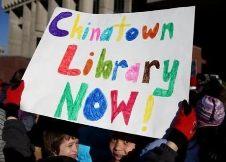 Students and teachers from Young Achievers School held a rally at City Hall for a Chinatown library branch.